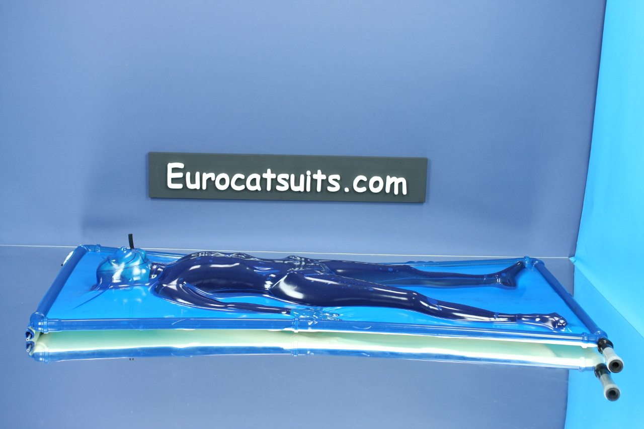 blue latex vacbed / vakuumbett with attached made to measure face and breathing hose and standard plastic frame ( stainless steel frame optional ). This vacuumbed creates very strong bondage . Because its airtight , you can enjoy it without noise of running vacuumcleaner . Click to see full resolution image.